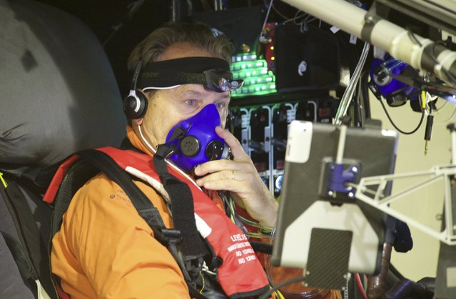 Swiss pilot Andre Boschberg sits in the cockpit of Solar Impulse 2 plane as he gets ready to take off at the Nanjing Lukou International Airport, Jiangsu province, China, May 31, 2015. The plane took off from eastern China's Nanjing after more than a month of delay to complete the most challenging leg yet of its Round The World adventure: the crossing of the Pacific via Hawaii. Pilots Piccard and Borschberg will take turns at the controls of Solar Impulse 2, which began its journey in Abu Dhabi in the United Arab Emirates on March 9, as it makes its way in the first round-the-world solar-powered flight in about 25 flight days at speeds of between 50 kph and 100 kph (30 mph to 60 mph). REUTERS/Stringer