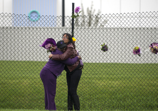 Teia Buroton, left, a Paisley Park volunteer, and another woman embrace outside the fences surrounding Paisley Park on April 21, 2016 in Chanhassen, Minnesota. Prince died earlier today at his Paisley Park compound at the age of 57. (Photo by Stephen Maturen/Getty Images)