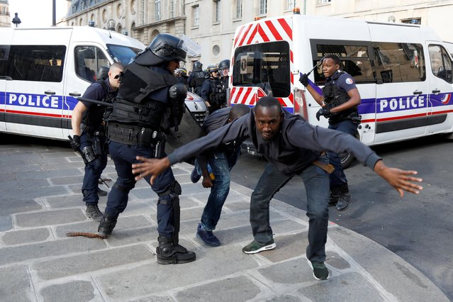 Riot police clash with undocumented migrants outside the Pantheon in Paris, France, July 12, 2019. (Photo by Charles Platiau/Reuters)