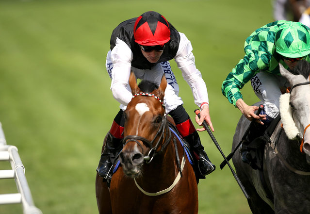 Free Eagle ridden by jockey Pat Smullen, red cap, comes home to win the Prince Of Wales's Stakes ahead of The Grey Gatsby during day two of the 2015 Royal Ascot Meeting at Ascot Racecourse, England, Wednesday June 17, 2015. (Steve Parsons/PA via AP)UNITED KINGDOM OUT  NO SALES  NO ARCHIVE