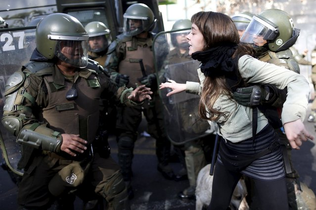 A student is detained by riot police during a demonstration to demand changes in the Chilean education system in Santiago, Chile June 25, 2015. (Photo by Ueslei Marcelino/Reuters)