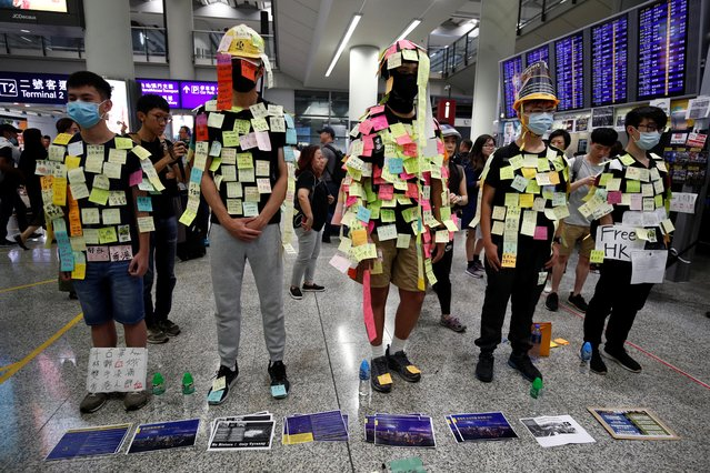 "Demonstrators wear post-it notes as part of the ""Lennon Wall"" movement during a protest against the recent violence in Yuen Long, at Hong Kong airport, China on July 26, 2019. More protests are expected on Saturday with demonstrators outraged at an attack on July 21 at a train station by armed men who police sources say included some with backgrounds in Hong Kong's triad criminal gangs. Some 45 people were wounded. (Photo by Edgar Su/Reuters)"