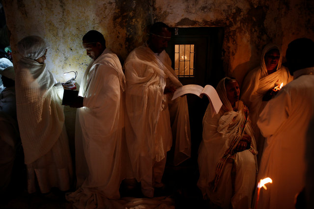 Ethiopian Orthodox worshippers hold candles during the Holy Fire ceremony at the Ethiopian section of the Church of the Holy Sepulchre in Jerusalem's Old City April 30, 2016. (Photo by Amir Cohen/Reuters)