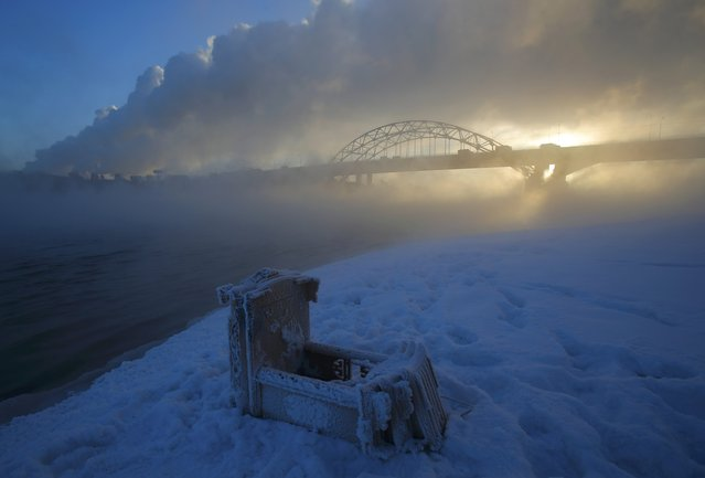 A Buddhist altar is seen laying on a bank as steam rises over the Moskva river on a frosty morning on the outskirts of Moscow, Russia February 7, 2017. (Photo by Maxim Shemetov/Reuters)