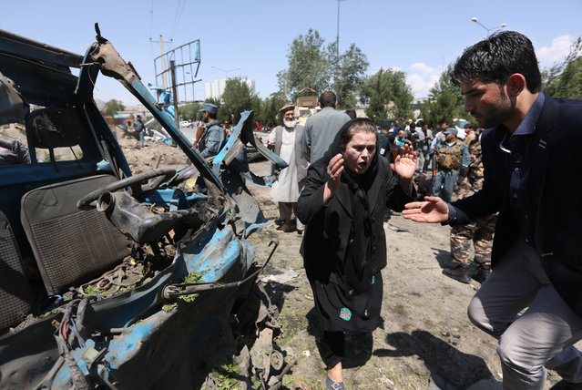 An Afghan woman cries out at the site of a suicide attack on a NATO convoy in Kabul, Afghanistan, Tuesday, June 30, 2015. (Photo by Rahmat Gul/AP Photo)