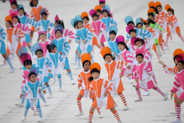 Young participants take part in the 54th National Day Parade in Singapore on August 9, 2019. (Photo by Roslan Rahman/AFP Photo)