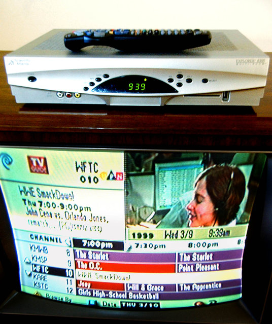 "This is a photo of the Scientific-Atlanta Explorer 8300 Multi-Room Digital Video Recorder, which allows cable television viewers to record two shows at once and play them back from any room in the house. The red bars, below on screen,  show that the machine is set to record both ""The O.C."" and ""Joey"" at the same time. Photo made Wednesday, March 9, 2005 in Bloomington, Minn. (Photo by Jim Mone/AP Photo)"