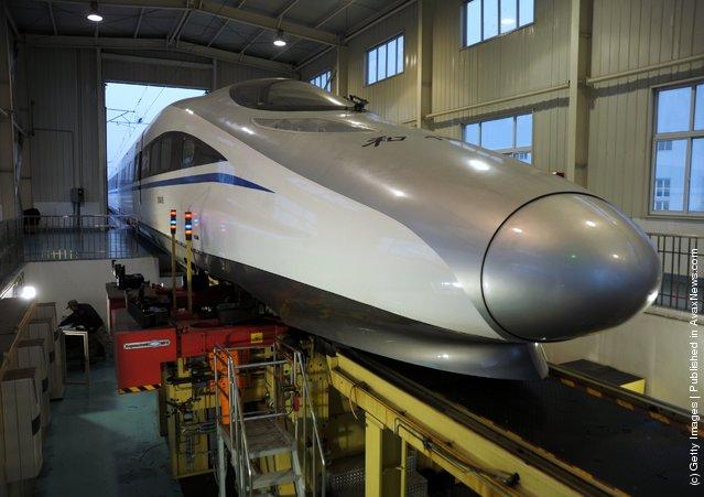 Technicians check a CRH high-speed train at Shanghai Hongqiao High-speed train base