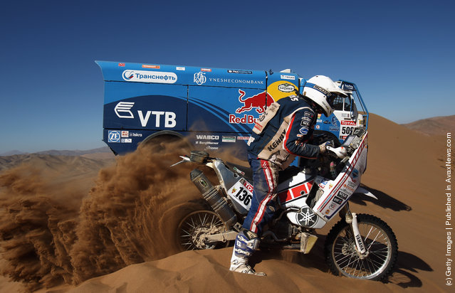 Gintautas Igaris of Lithuania and Franco Picco Racing rides up a sand dune during stage seven of the 2012 Dakar Rally
