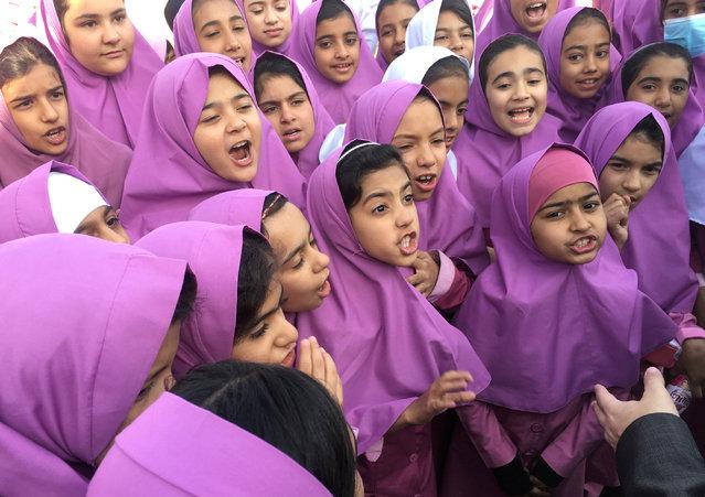 Iranian and Afghan girls gather at the Emam Hasan Mojtaba school in Kerman, Iran, October 23, 2016. (Photo by Gabriela Baczynska/Reuters)