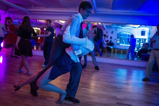 People dance during a swing class in the dance studio of the Tango Factory Budapest, in Budapest, Hungary, 24 April 2017 (issued 28 April). (Photo by Bea Kallos/EPA)