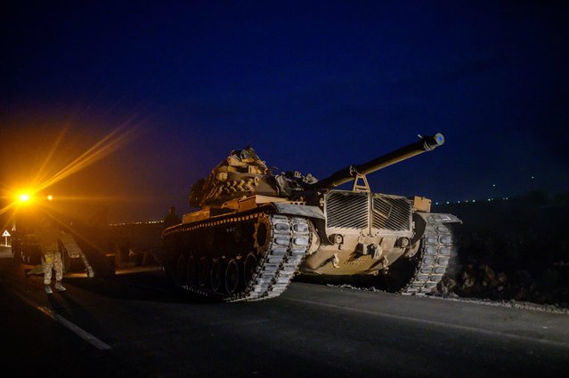 """A Turkish army's tank drives towards the border with Syria near Akcakale in Sanliurfa province on October 8, 2019. Turkey said on October 8, 2019, it was ready for an offensive into northern Syria, while President Donald Trump insisted the United States had not abandoned its Kurdish allies who would be targeted in the assault. Trump has blown hot and cold since a surprise announcement two days before that Washington was pulling back 50 to 100 """"special operators"""" from Syria's northern frontier. (Photo by Bulent Kilic/AFP Photo)"""