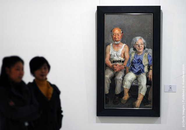 Visitors view the work entitled 'Golden Jubilee' by Chinese artist Xin Dongwang at the 'Extension and Integration: A Circuit Exhibition In Hubei Of Study on the Modern Chinese Oil Painting' at the Hubei Museum of Art