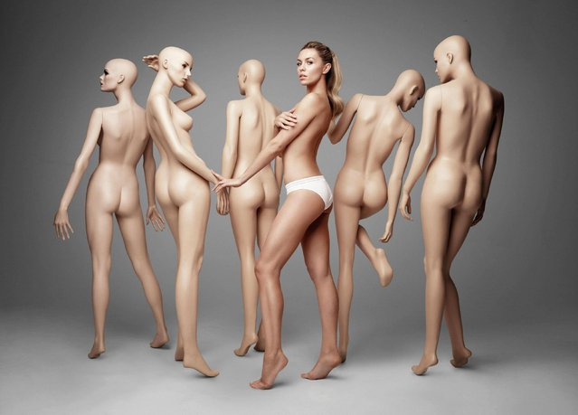 Photo issued by Virgo Health of the 28-year-old Abbey Clancy who has been revealed as the new ambassador for Veet and Scholl on May 19, 2014, and she certainly seems the right candidate to be promoting smooth skin. The mother-of-one looks absolutely flawless as she wears next to nothing whilst posing up with a group of shop window mannequins. Wearing just a pair of white skimpy knickers, Abbey and the brands are encouraging the public to bare their skin with confidence as the weather warms up and summer approaches. (Photo by Virgo Health/PA Wire)