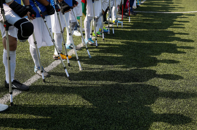 Amputee soccer players line up before a friendly match between Ukrainian and Azeri teams in Kiev, Ukraine on September 11, 2019. (Photo by Valentyn Ogirenko/Reuters)
