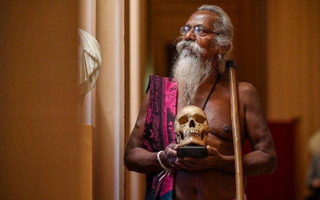 Wani Uruwarige, chief of the ancient Sri Lankan jungle dwelling tribe the Vedda people, attends a ceremony in the University of Edinburgh's Playfair Library on November 22, 2019 in Edinburgh, Scotland. The university returned a set of nine human skulls it acquired over 100 years ago and had housed in their anatomical collection. The Vedda plan to display the skulls in an exhibition back home that will showcase their traditional ways of life. (Photo by Jeff J Mitchell/Getty Images)