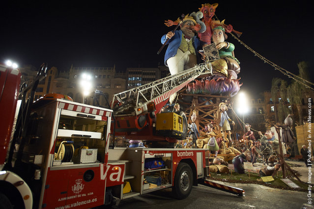 People prepare for the burning of the 'Ninot' caricatures during the last day of the 'Fallas' festival on March 19, 2012 in Valencia, Spain
