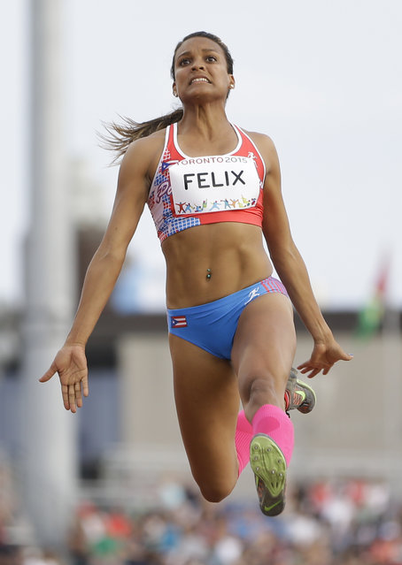 Alysbeth Felix of Puerto Rico competes in the women's heptathlon long jump at the Pan Am Games Saturday, July 25, 2015, in Toronto. (Photo by Mark Humphrey/AP Photo)