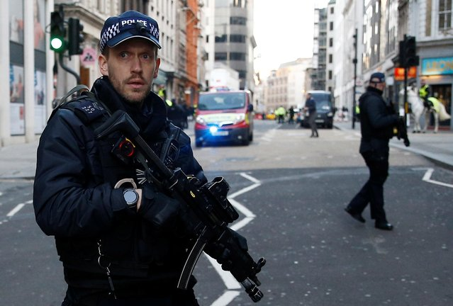 A Police officer is seen in the City, near the site of an incident at London Bridge in London, November 29, 2019. The Metropolitan Police on Friday said several people were injured and a man was held after a stabbing near London Bridge in the centre of the British capital. (Photo by Peter Nicholls/Reuters)