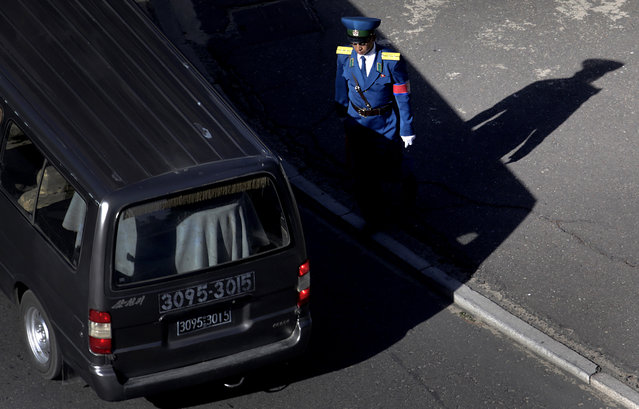 A North Korean traffic policeman performs his duties, Monday, May 4, 2015 in Pyongyang, North Korea. (Photo by Wong Maye-E/AP Photo)
