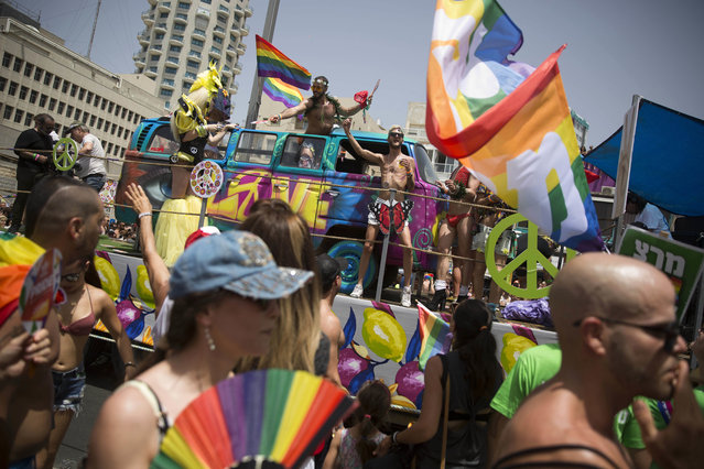 People participate the annual Gay Pride Parade in Tel Aviv, Israel, Friday, June 3, 2016. (Photo by Oded Balilty/AP Photo)