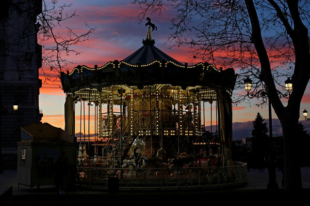 A carousel is seen outside the Royal Palace in Madrid, Spain January 16, 2017. (Photo by Juan Medina/Reuters)