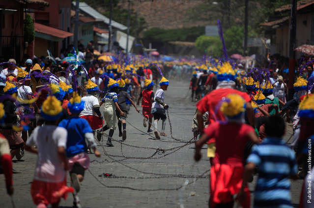 """People participate in """"Los Encadenados"""", or """"The Chained Ones"""" procession on Good Friday during Holy Week in Masatepe, Nicaragua"""
