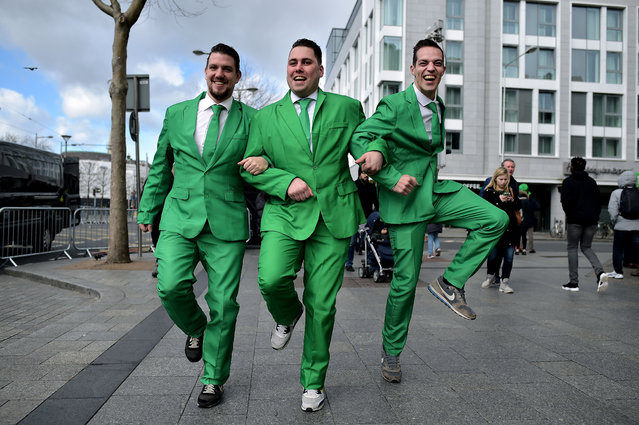 Revellers attend the Saint Patrick's Day parade on March 17, 2019 in Dublin, Ireland. Saint Patrick, the patron saint of Ireland is celebrated around the world on St. Patrick's Day. According to legend Saint Patrick used the three-leaved shamrock to explain the Holy Trinity to Irish pagans in the 5th-century after becoming a Christian missionary. (Photo by Charles McQuillan/Getty Images)