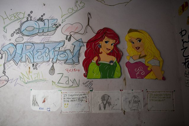 In this June 1, 2016 photo, the bedroom wall of Maria Arias is decorated with drawings and Disney characters in Caracas, Venezuela. Amid high student drop out rates, food shortages and increasing violence in Caracas, Arias' parents worry most about boys. Venezuela now has the highest teen pregnancy rate in South America, according to the United Nations. (Photo by Ariana Cubillos/AP Photo)