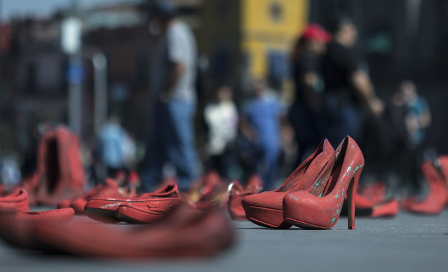 Women's red shoes are spread out in the Zocalo where they were placed by people to protest violence against women in Mexico City, Saturday, January 11, 2020. There are 10 women killed daily on average across Mexico, and only one in 10 such crimes are solved, according to the National Citizens' Observatory on Femicide. (Photo by Christian Palma/AP Photo)