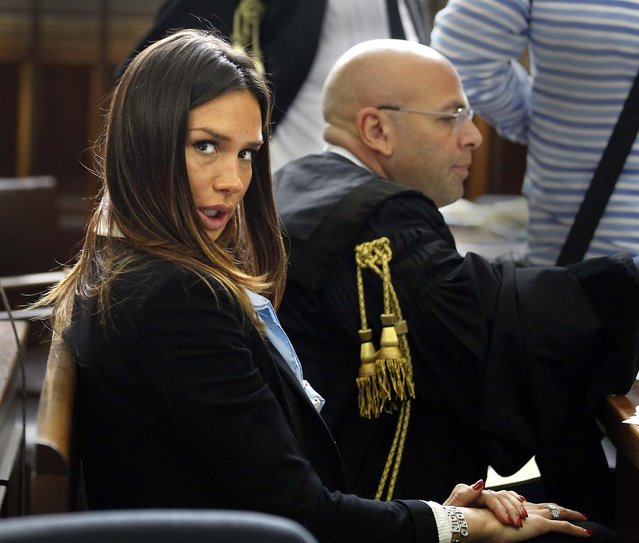 "Former showgirl Nicole Minetti looks at the camera during a break in her trial with ex-Italian Premier Silvio Berlusconi aides, Emilio Fede, an executive in Berlusconi's media empire, and talent agent Dario ""Lele"" Mora, on charges they allegedly recruited an underage Moroccan girl and other women for prostitution at Berlusconi's villas on May 11, 2012"