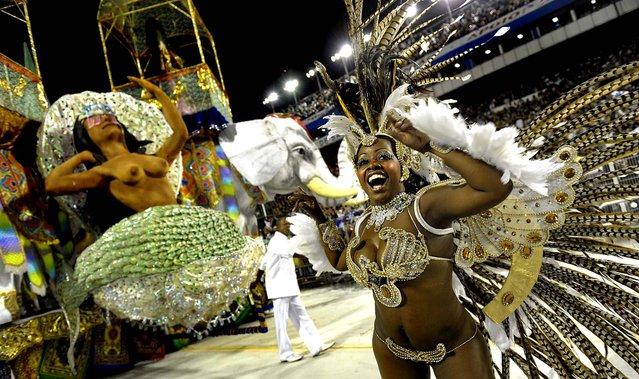 A reveller of the Nene de Vila Matilde samba school dances ahead of a float during at the Sambadrome in Sao Paulo