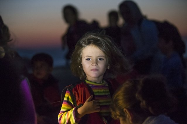 A migrant girl looks towards the see as they arrive on a dinghy at the southeastern island of Kos, Greece, after crossing from Turkey, Thursday, August 13, 2015. Greece has become the main gateway to Europe for tens of thousands of refugees and economic migrants, mainly Syrians fleeing war, as fighting in Libya has made the alternative route from north Africa to Italy increasingly dangerous. (Photo by Alexander Zemlianichenko/AP Photo)