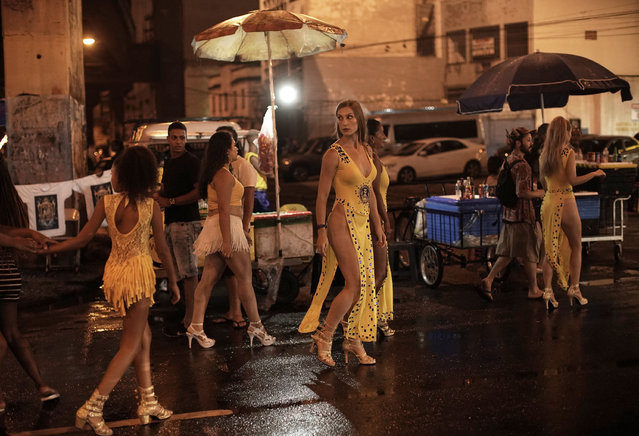 In this January 13, 2020 photo, Natasha Kovalenko walks to a street rehearsal of the Paraiso de Tuiuti samba school in Rio de Janeiro, Brazil. Kovalenko, who came all the way from Russia to dance with the Paraiso de Tuiuti samba school in the carnival parade, will return home after it's over. (Photo by Silvia Izquierdo/AP Photo)