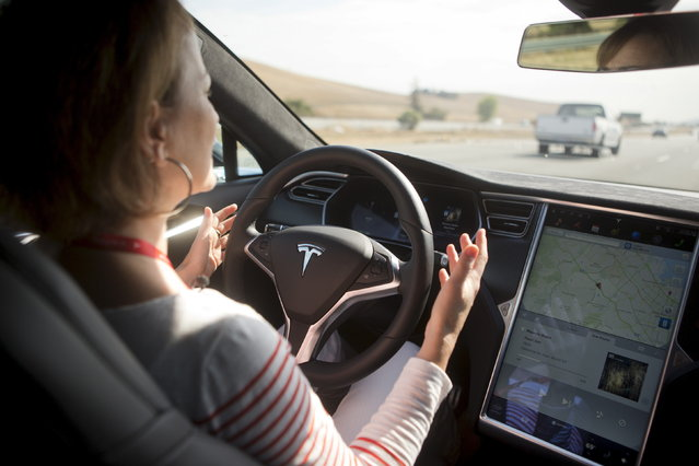 "New autopilot features are demonstrated in a Tesla Model S during a Tesla event in Palo Alto, California, 2015. Federal officials say the driver of a Tesla S sports car using the vehicle's ""autopilot"" automated driving system has been killed in a collision with a truck, the first U.S. self-driving car fatality. The National Highway Traffic Safety Administration said preliminary reports indicate the crash occurred when a tractor-trailer made a left turn in front of the Tesla at a highway intersection. (Photo by Beck Diefenbach/Reuters)"