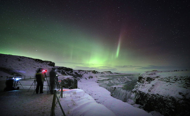 Aurora Borealis, or Northern Lights, shine over Gulfoss waterfall in Iceland on January 16, 2018. (Photo by Owen Humphreys/PA Images via Getty Images)