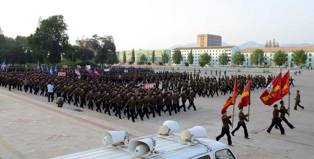 North Koreans who signed up to join the army march in the midst of political tension with South Korea, in this undated photo released by North Korea's Korean Central News Agency (KCNA) in Pyongyang August 23, 2015. (Photo by Reuters/KCNA)