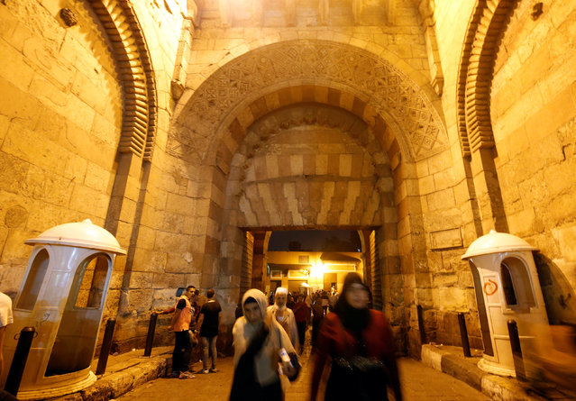 "People walk through the historic Zuwayla, or ""Bab Zuwayla"" after their iftar (breaking fast) meal during the Muslim fasting month of Ramadan, in old Cairo, Egypt June 16, 2016. (Photo by Amr Abdallah Dalsh/Reuters)"