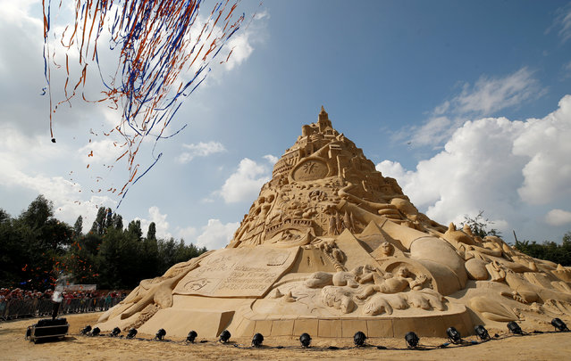 Confetti is shot into the sky as the world's highest sand castle receives the official confirmation by a judge of Guinness World Records with the new record height of 16.68 metres in Duisburg, Germany, September 1, 2017. (Photo by Wolfgang Rattay/Reuters)