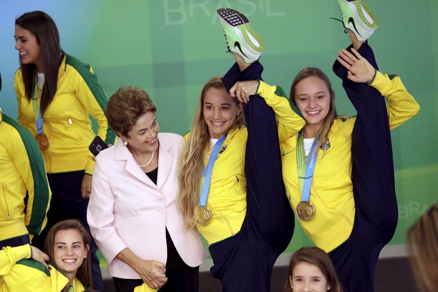 Brazil's President Dilma Rousseff attends a reception ceremony for the delegation of Brazil in the Pan American Games and Parapan American of Toronto in 2015 and tribute to the 10 years of the program Bolsa Atleta (Bolsa Athlete), at the Planalto Palace in Brasilia, Brazil August 27, 2015. (Photo by Ueslei Marcelino/Reuters)