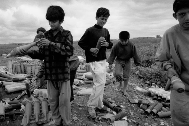 Children are often the casualties of left-behind war ordnance. The day after this photograph was taken in Kirkuk, three of the children pictured died after putting a bomb they had collected into a fire. (Photo by Sean Sutton for the Mines Advisory Group/The Guardian)