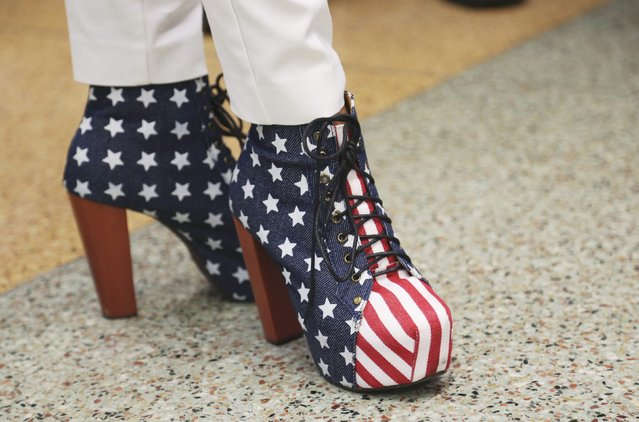 A delegate shows off patriotic shoes at the Republican National Convention in Cleveland, Ohio, U.S. July 18, 2016. (Photo by Aaron Josefczyk/Reuters)