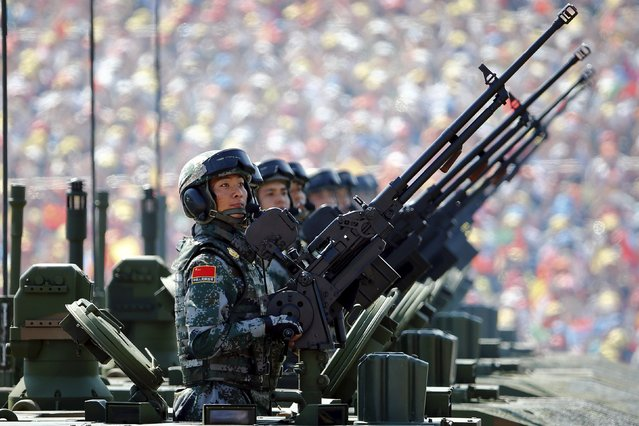 Soldiers of the People's Liberation Army (PLA) of China arrive on their armoured vehicles at Tiananmen Square during the military parade marking the 70th anniversary of the end of World War Two, in Beijing, China, September 3, 2015. (Photo by Damir Sagolj/Reuters)