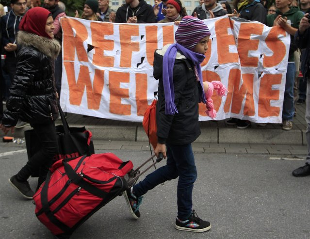 Migrants are welcomed as they arrive at the main railway station in Dortmund, Germany September 6, 2015. (Photo by Ina Fassbender/Reuters)