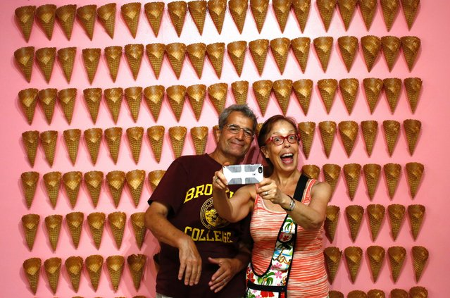 Visitors pose at the Museum of Ice Cream across from the Whitney Museum on July 29, 2016 in New York City. The temporary museum dedicated to all things ice cream will be open for the month of August. (Photo by Kena Betancur/Getty Images)