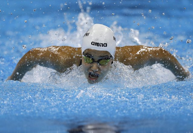 Yusra Mardini, swimming for the Refugee Olympic Team, competes in a women's 100m butterfly heat during the swimming competitions at the 2016 Summer Olympics, Saturday, August 6, 2016, in Rio de Janeiro, Brazil. (Photo by Michael Sohn/AP Photo)