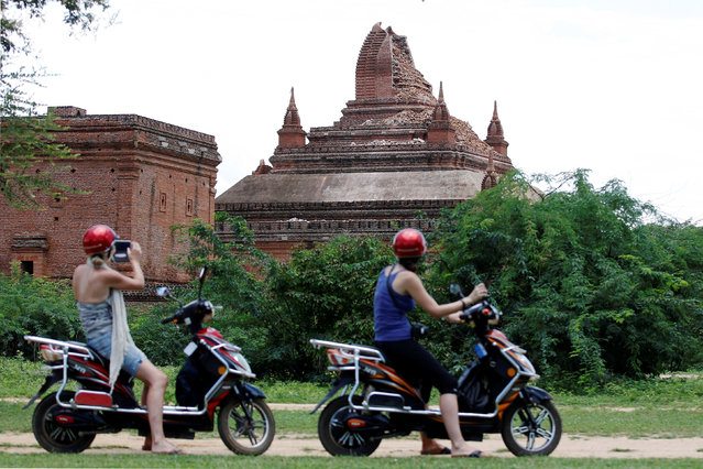 Tourists take pictures of a damaged pagoda after an earthquake in Bagan, Myanmar August 25, 2016. (Photo by Soe Zeya Tun/Reuters)