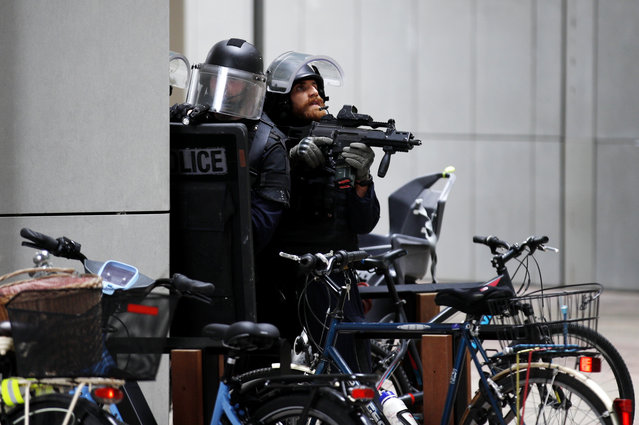French police officers patrol at La Defense business district following reports of a gunman near Paris, France, 30 June 2020. Police evacuated hundreds of people with hands up from the Les Quatre Temps shopping centre around 9.30am after a shop worker reported seeing a masked man carrying a rifle or shotgun. The police operations ended after confirmation it was a false alarm. (Photo by Yoan Valat/EPA/EFE)