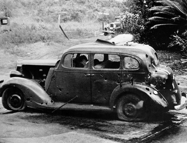 Eight miles from Pearl Harbor, shrapnel from a Japanese bomb riddled this car and killed three civilians. The Navy reported there was no nearby military objective. (U.S. Navy/Associated Press)