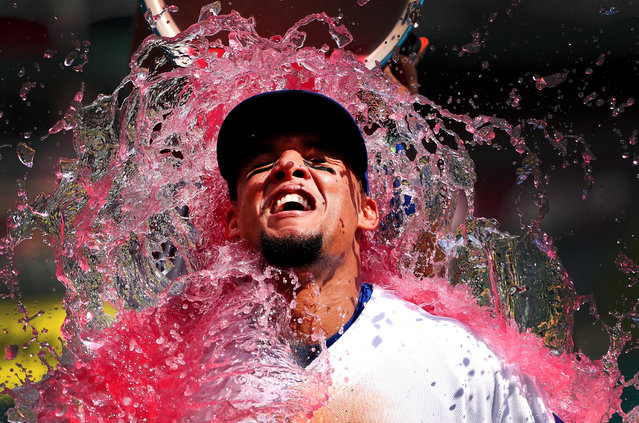 Carlos Gomez #14 of the Texas Rangers is soaked with a Powerade cooler after the Texas Rangers beat the Seattle Mariners 14-1 at Globe Life Park in Arlington on August 31, 2016 in Arlington, Texas. (Photo by Tom Pennington/Getty Images)